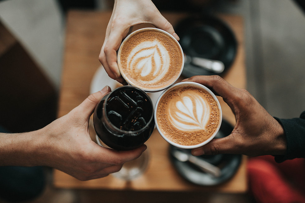 3 hands cheersing with coffee drinks