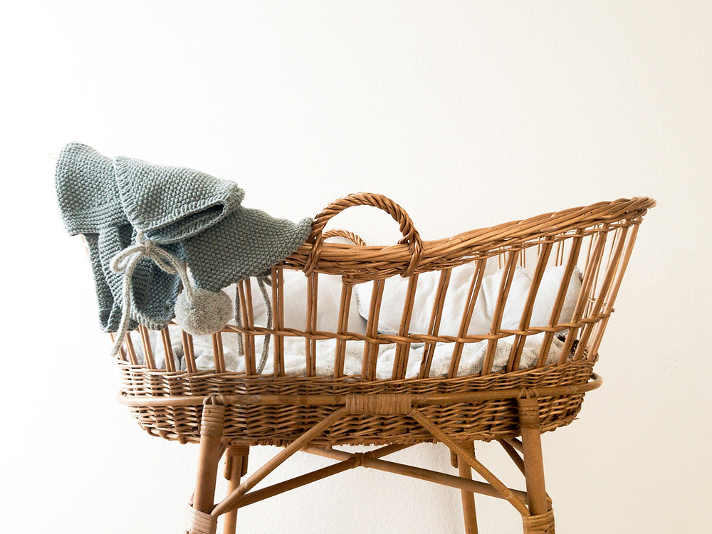 a wicker crib for a baby