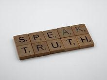 """Letter tiles spelling """"Speak Truth"""""""