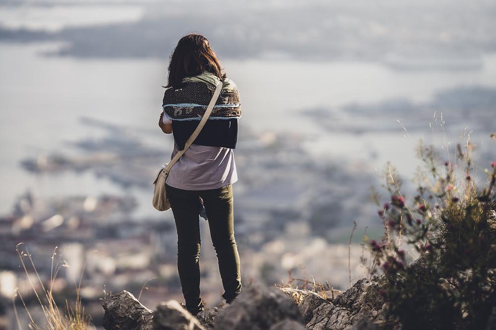 Sad woman looking down a hill