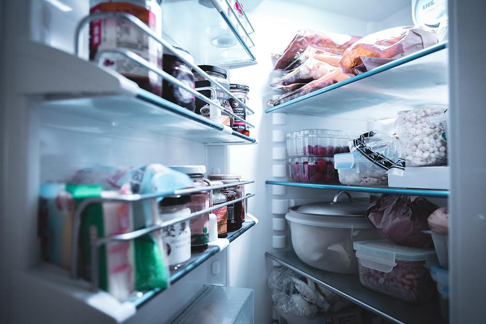 A fridge with the door open.