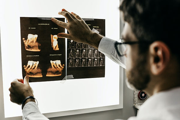 Image of a doctor in a dental emergency situation looking at x-ray Image by Jonathan Borba