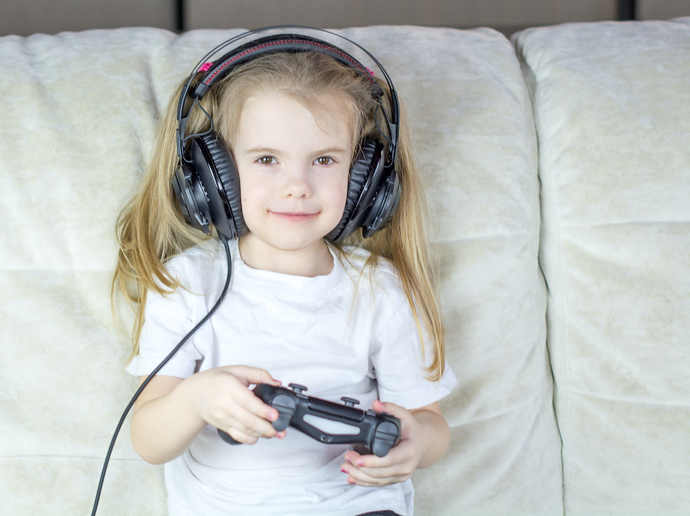 girl with game controller and headphones