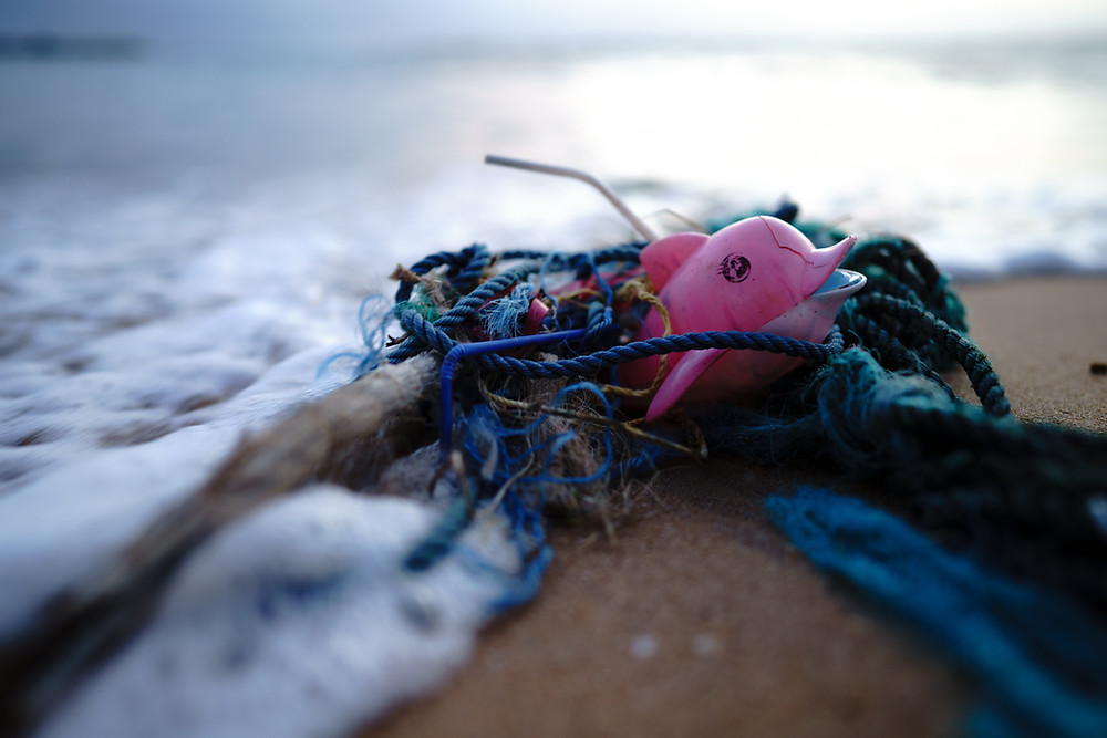 Plastic trash washed up on a beach.