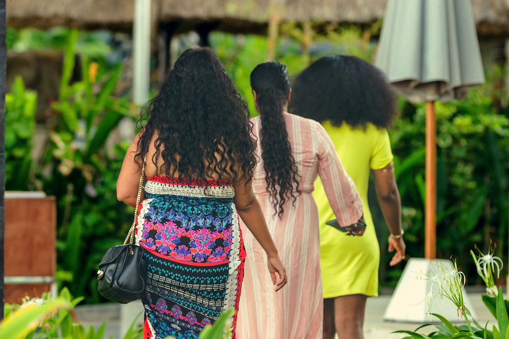 Women of color traveling tropical vacation