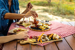 Friends Enjoying Lunch Outdoors at Picnic Table