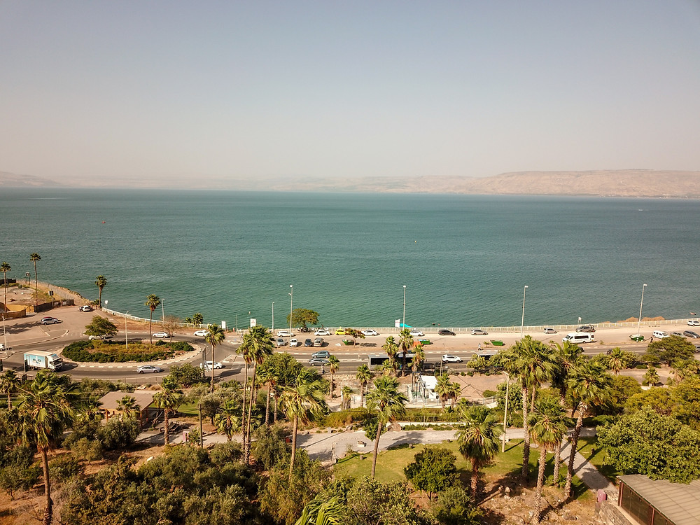 An aerial view of the Kinneret and shore road