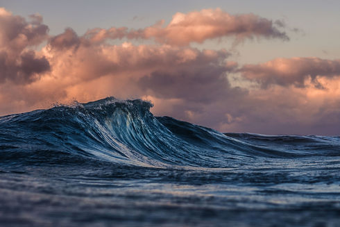 Image by Silas Baisch of an ocean wave. The image represents what big emotions can feel like without the help of a therapist.