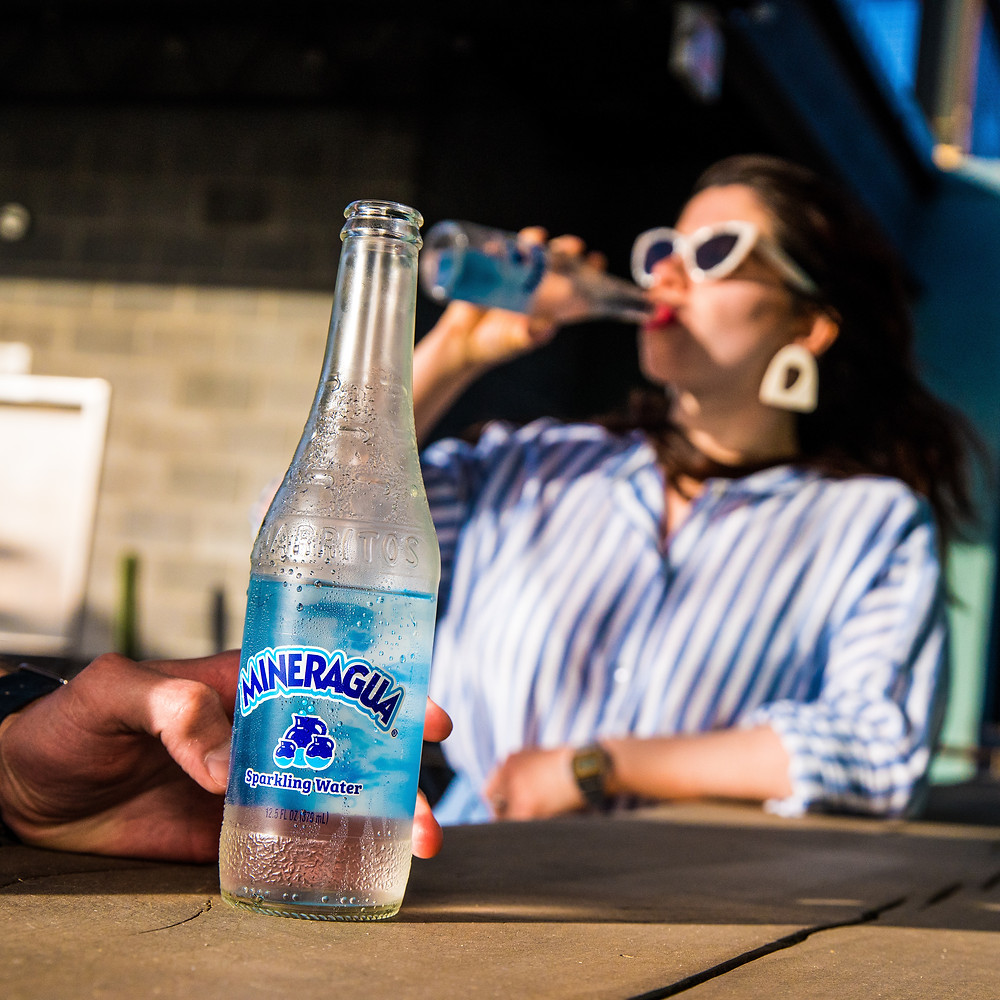 woman drinking sparkling water