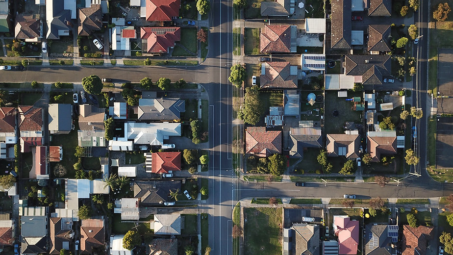 Birdseye Image of suburban housing and streets, by Tom Rumble