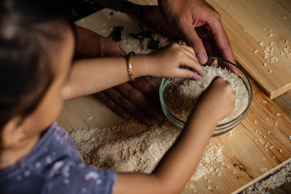 family preparing rice