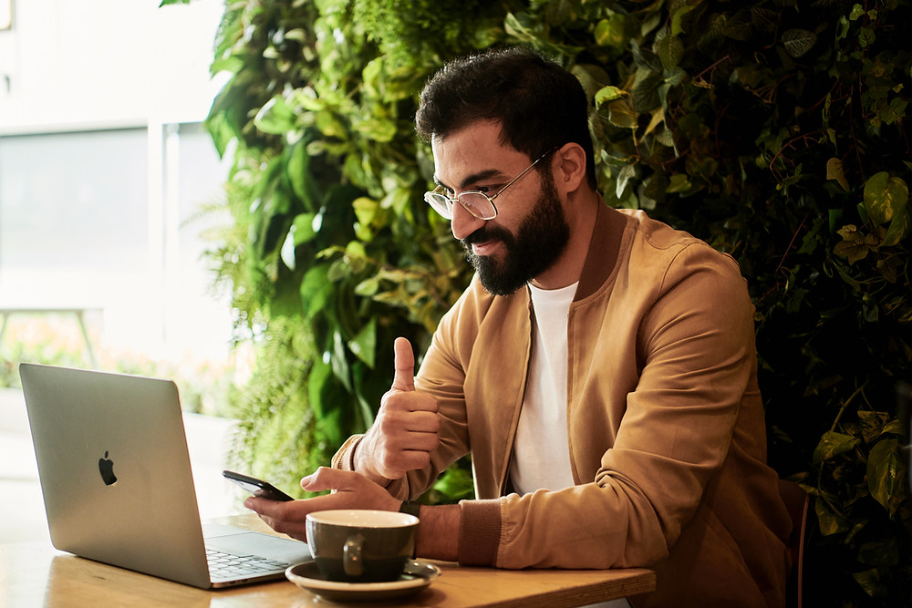 man on laptop running small business