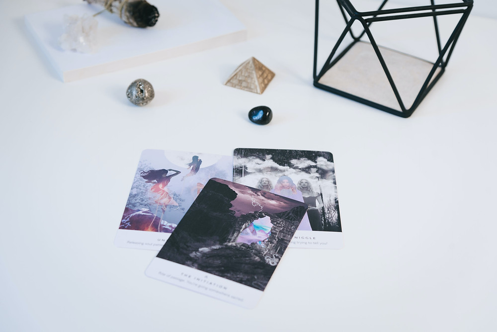 Three oracle cards showcasing Danielle Noel's work are centered on a white background.