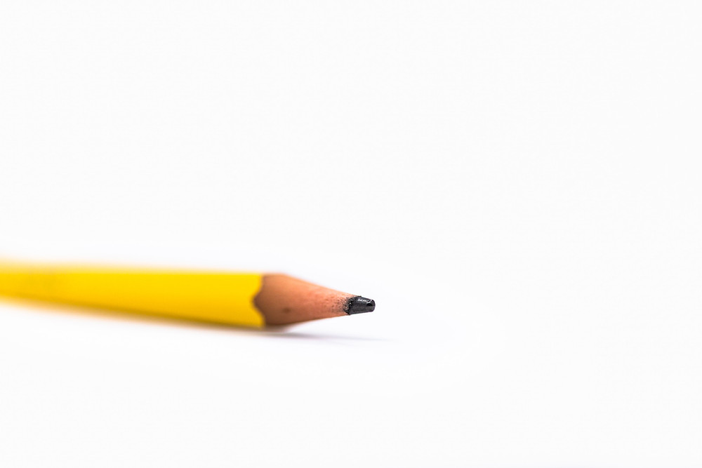 A sharpened pencil on a white surface