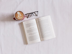 Coffee Cup with an Open Book