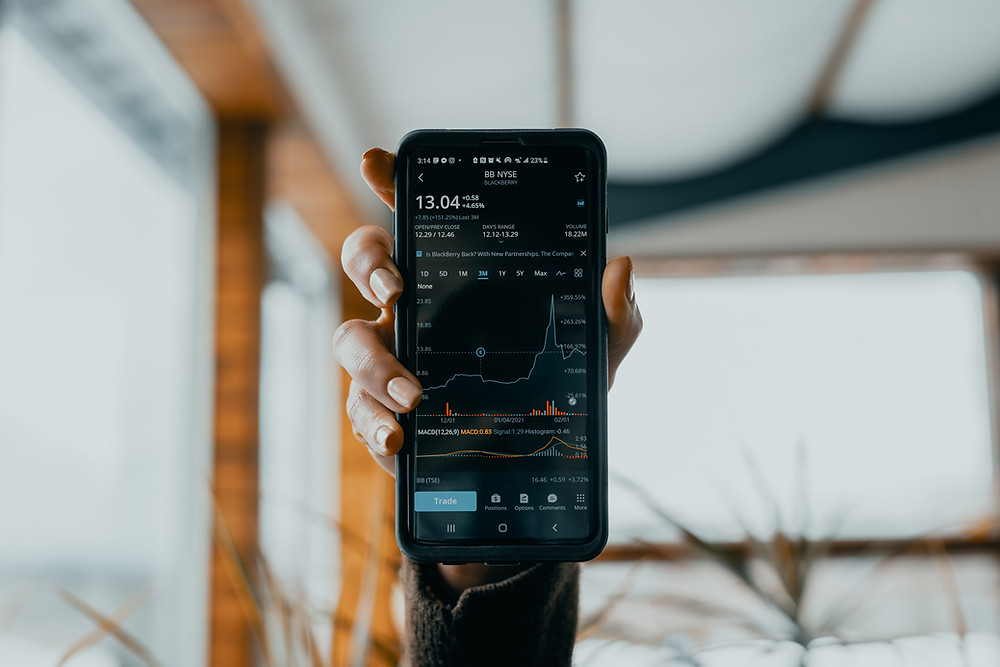 day trader showing off his/her traders on a mobile trading device.