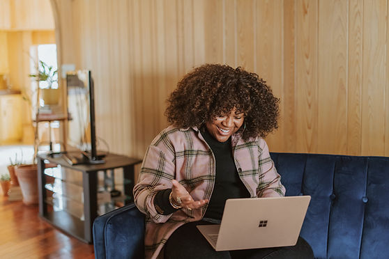 Black woman excited looking on computer