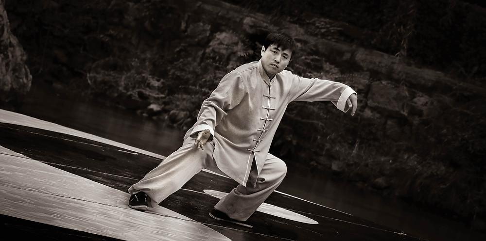 Asian man doing Tai Chi
