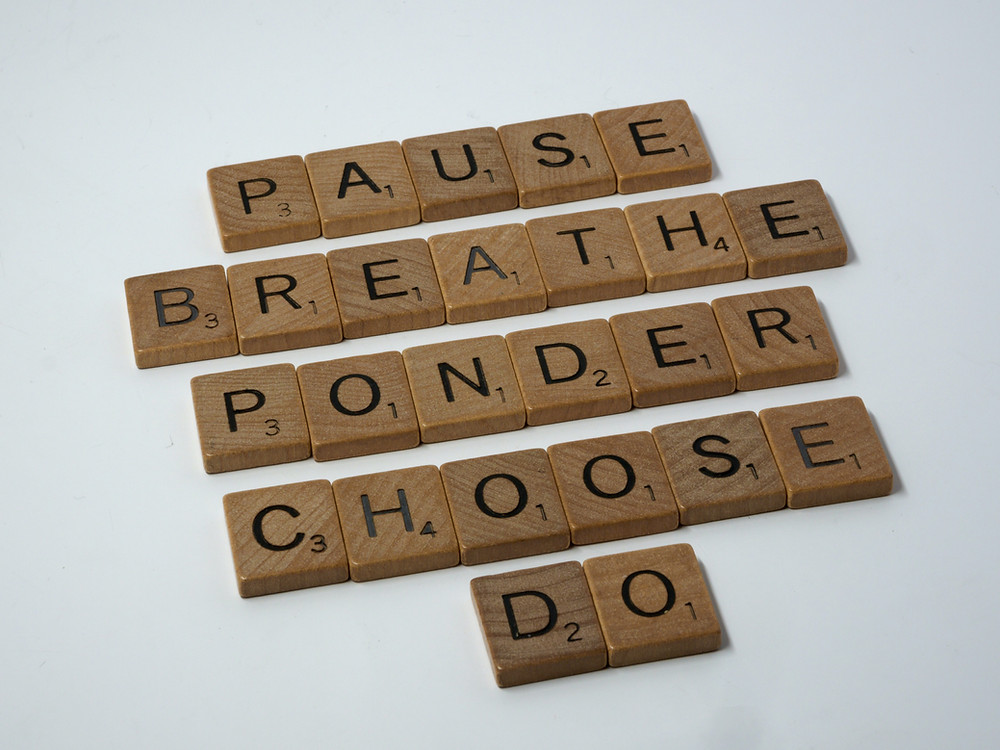 Scrabble tiles spelling the words Pause, Breathe, Ponder, Choose, Do