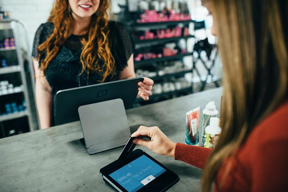 Customer Paying At Counter