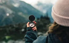 Avalanch accessories - image of woman holding up a navigational compass