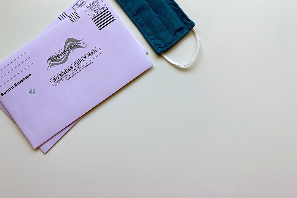 Voter ballot envelope with a mask.