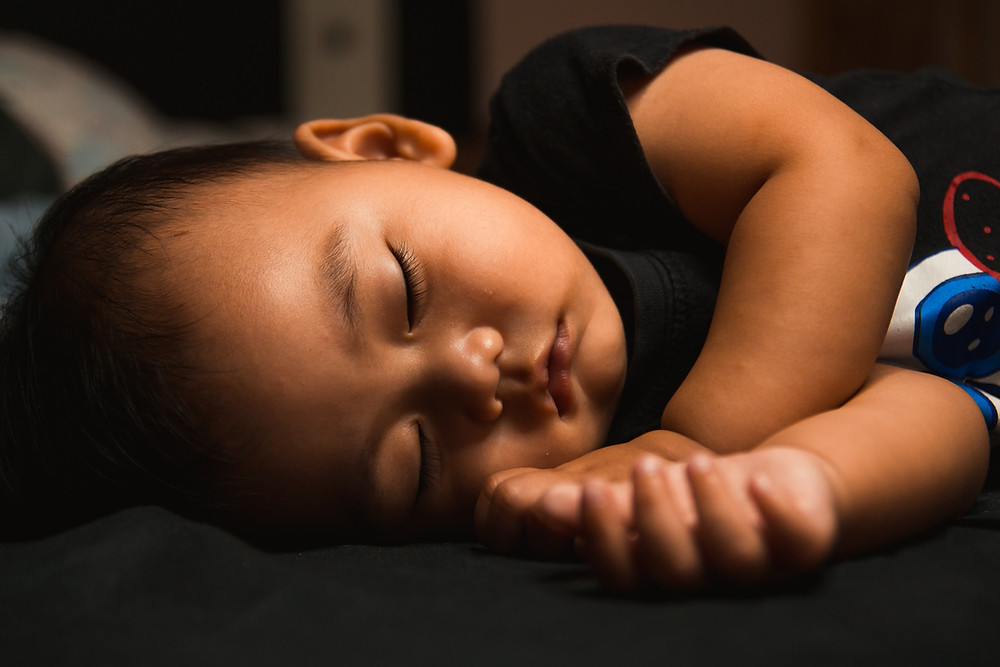 toddler sleeping on his side