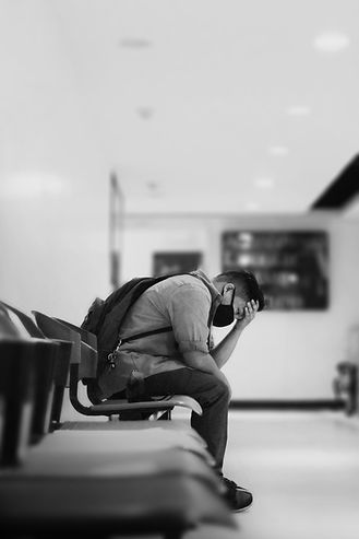 Depression Counselling - man sitting in waitroom feeling depressed