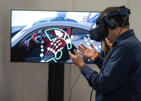 courious young man testing virtual reality