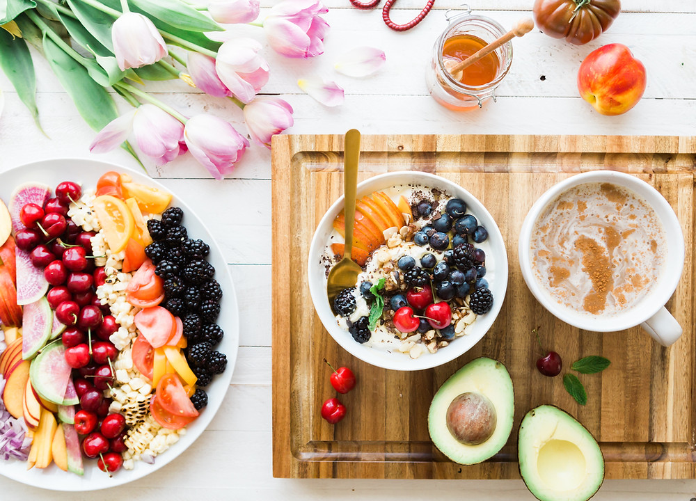 healthy breakfast food with fruit bowl and avocodo