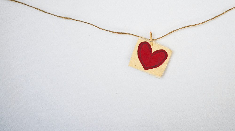 Embroidered heart pegged to length of string