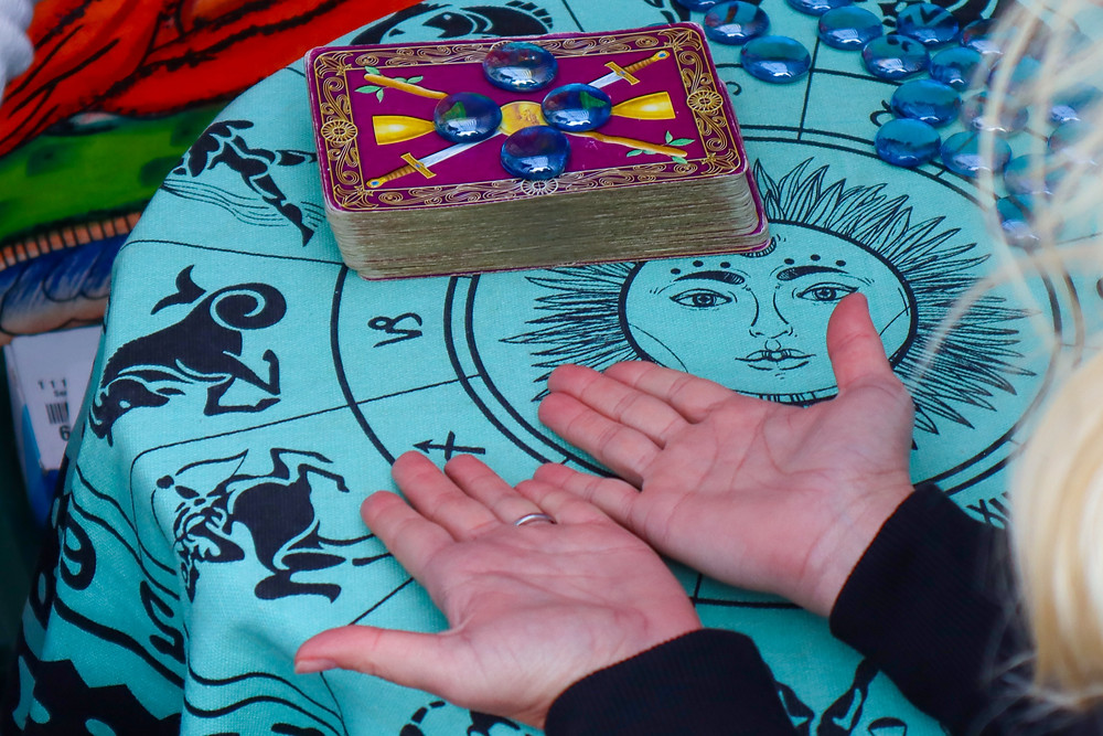 Fortune tellers can use a tarot or oracle deck depending on what the client wishes to get out of the reading