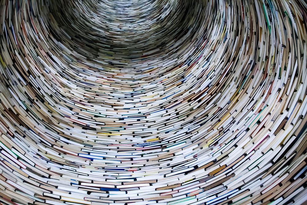 circular tunnel made of books