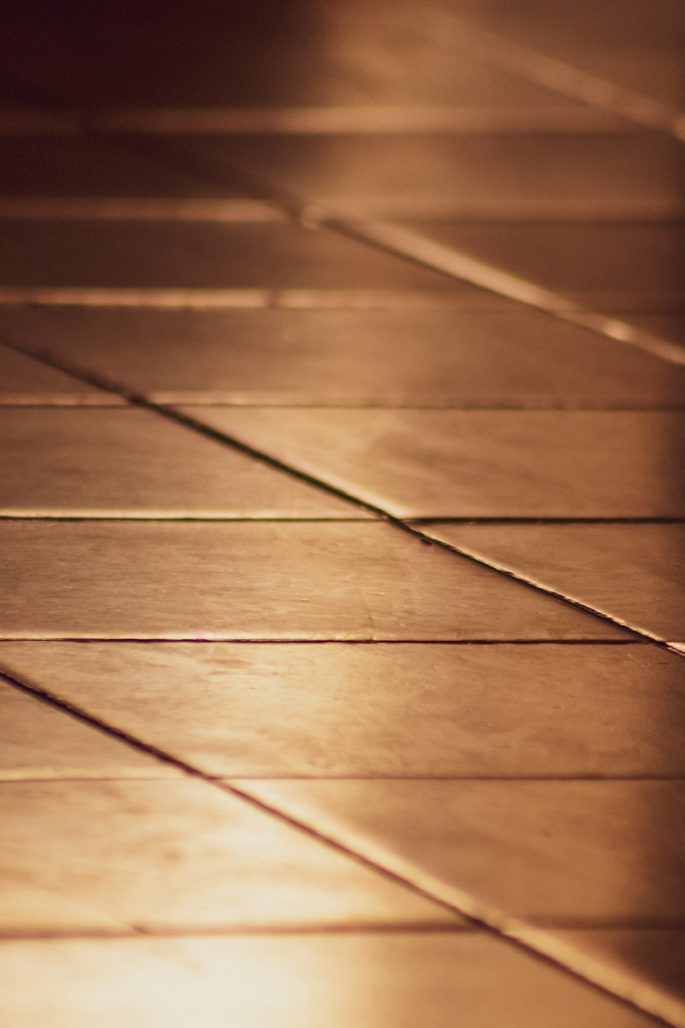 Image of brown tile with brown grout.