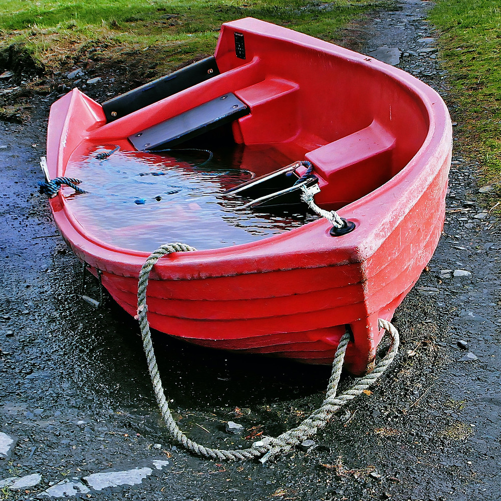 boat full of water on shore