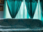 Clean delicate drapery can tie a room together.