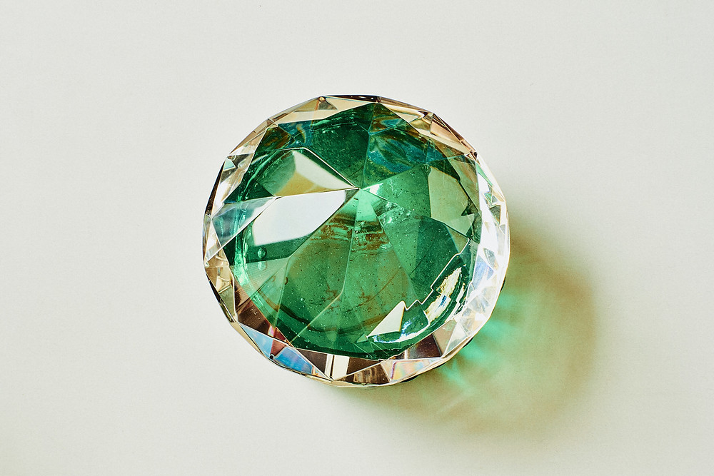 Multi-faceted diamond reflecting green light