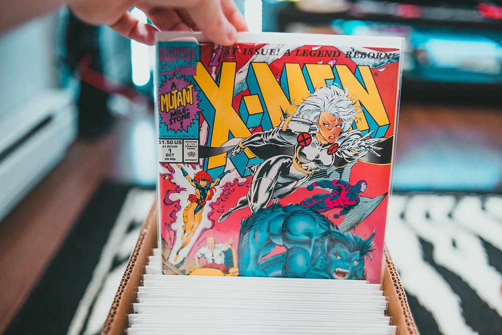 An X-Men comic book being held up from a box