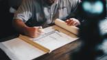 man looking at architectual drawings