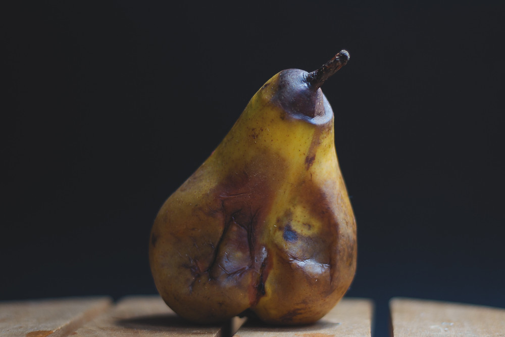 mouldy pear rotten fruit
