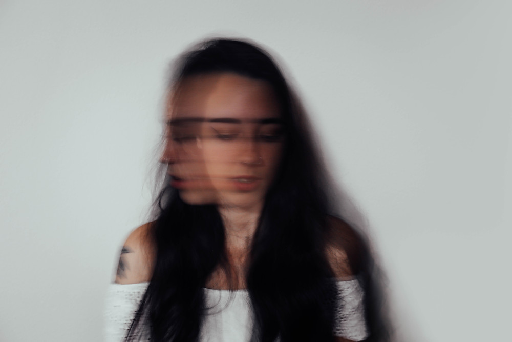 Woman suffers from anxiety but does not know which type.Catalyss Counseling provides treatment for depression and anxiety in Colorado through online therapy and in person counseling in the Denver area 80209 and 80210