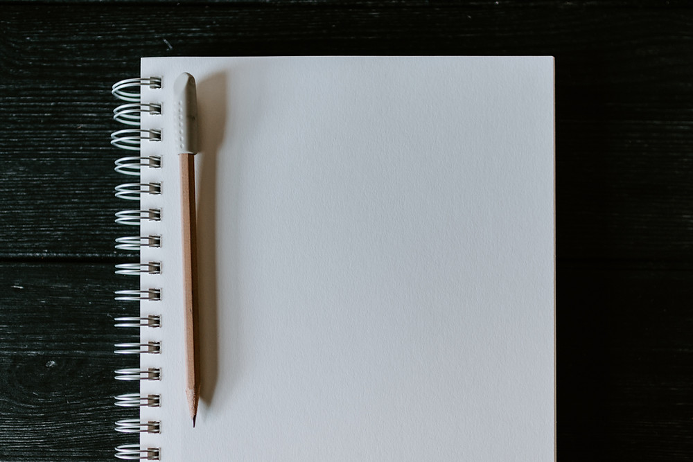I Sprinkled Some Redundancy On The Page: Image showing the blank page of a notebook with a pencil.