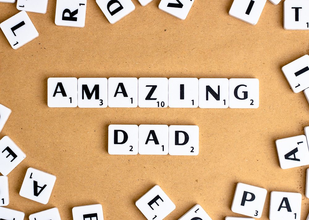 scrabble game piece tiles spelling out Amazing Dad for Father's Day message