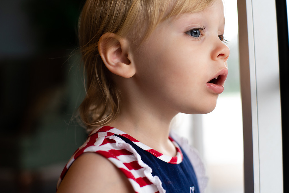 Image of girl looking out a window