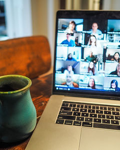 Image of video conference on laptop screen