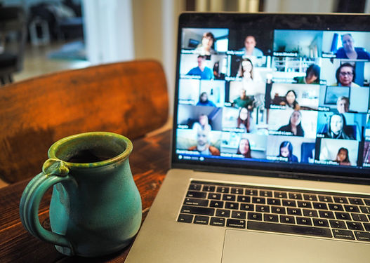 Image of video conference on computer screen with coffee mug, by Chris Montgomery