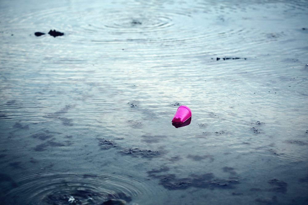 plastic cup floating in water Manitoba