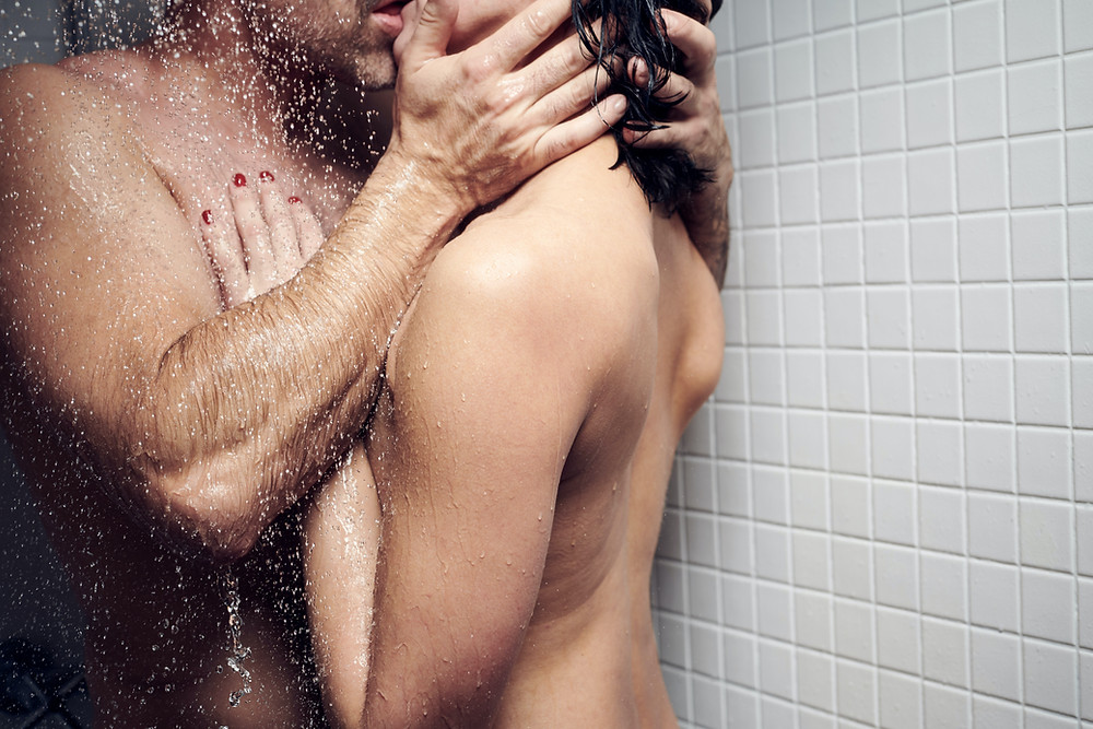 Erotic Couple kissing under the shover. Symbol for Illustrated Erotic Stories