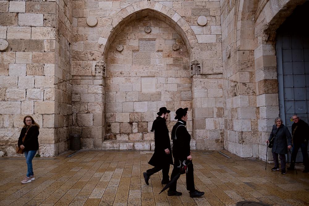 2 men walking through the Old City of Jerusalem