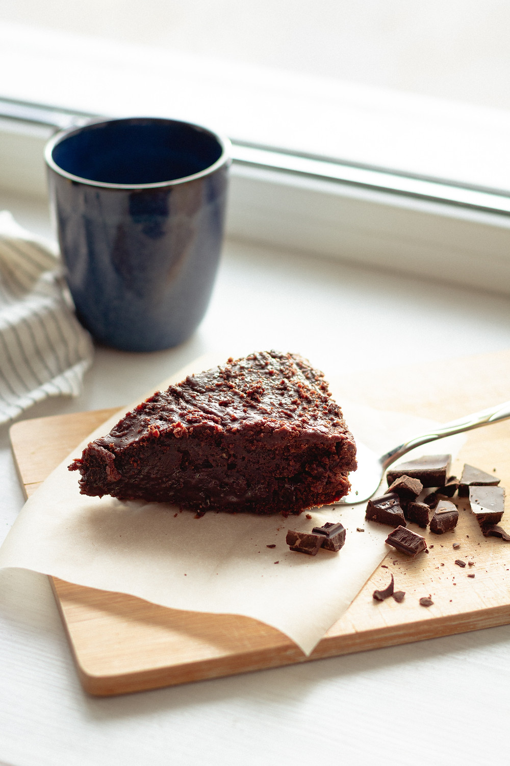 Cup of coffee and piece of chocolate cake